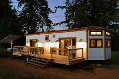 This custom park model tiny house was shipped to Maui and includes a full-size chef's kitchen, two bedrooms, large outdoor deck, and two skylights.
