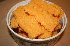 Cheese Straws, a southern thing that is sooo good. They appear at cocktail parties, weddings, and important occasions. My grandmother made these but cut them longer and twisted them before baking....yum!