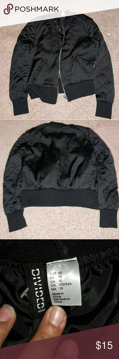 "Nwot Black bomber jacket Nwot Black bomber jacket  It's really cute but I can't fit it Size 10 Shoulder to shoulder  is 15"" Each Arm is 25"" Width is 20"" From h&m Black satin material Divided Jackets & Coats"