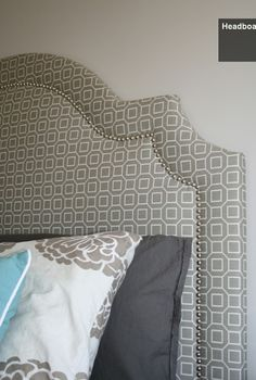 DIY Upholstered Headboard. Pattern, shape, and nail heads.