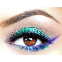 Bright teal and purple winged eyeshadow with glitter #vibrant #glitter #bold #eye #makeup #eyes #eyeshadow