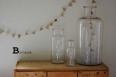 Neutrals. #bunting #glass #jars #display