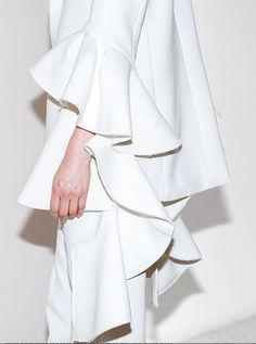 Contemporary Fashion white suit with frill sleeve detail; modern tailoring // Ellery