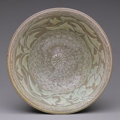 Joseon dynasty (1392–1910), second half of 15th century Korea Stoneware with inlaid and stamped decoration of peony leaves and chrysanthemum flowers under buncheong glaze H. 2 7/8 in. (7.3 cm) Purchase, the Vincent Astor Foundation Gift, 2002 (2002.132)
