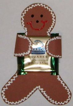 PRESCHOOL CHRISTMAS CRAFT: Gingerbread Man Candy holders    Bag of Ghirardelli choclate squares  Medium Brown Cardstock  Scissors  Tape (double stick optional)  Puffy Paint -shiny white, black & red
