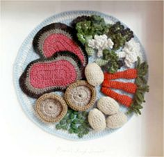 UK knitwear designer and crochet artist Kate Jenkins has created several full installations of crochet food including a cafe and a dinner party. She also has a home/fashion line and designed the decor for a hotel room.