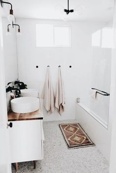Bathroom Inspiration: The Do's and Don'ts of Modern Bathroom Design Laundry In Bathroom, Bathroom Inspo, Bathroom Interior, Pastel Bathroom, Blush Bathroom, Washroom, Neutral Bathroom, Bathroom Hooks, Bohemian Bathroom