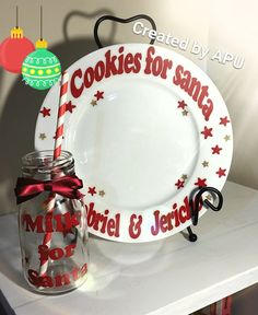 """A white ceramic plate and a little glass milk bottle creates this perfect set. Each set includes plate with """"Cookies for Santa"""" & your childs name or names. You might prefer to put your Family name. The bottle will include a ribbon a paper straw and of course """"Milk for Santa"""" written on it. When ordering please leave a message telling me the names you would like and if you would red or green vinyl for the wording. A great gift and something that can be used year after year. P..."""