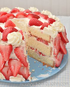 Heavenly Strawberries 'n Cream Cake Recipe ~ Not only does this cake look amazing, it tastes just as delicious. With fresh strawberries, homemade whipped cream, and a pound-cake-type texture, Strawberries 'n Cream Cake is the perfect strawberry dessert.