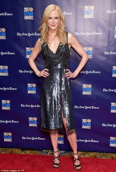 Movie star:Nicole looked every inch the glamorous movie star as she sparkled in the silver plunging gown