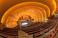 The view of the stage from the balcony as workers prepare for a show in historic Radio City Music Hall in New York City Famous Buildings, Famous Landmarks, Hall Interior, Radio City Music Hall, City Scene, Concert Hall, Art Deco Design, New York City, Architecture Design