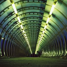 Line direction: the line of lights leads a persons' focus towards the dark end of the tunnel.