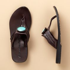 NADIA SANDALS�--�Crafted in Thai villages, buffalo leather sandals are rustically stunning and sturdy, crowned with a turquoise howlite stone. Rubber sole. Whole sizes 6 to 11.