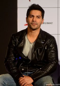Varun Dhawan looks cool in a biker jacket, striped T-shirt and ripped jeans. via Voompla.com