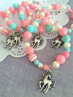 Unicorn kids birthday party favor, unicorn jewelry, kids jewelry, SET of TEN. ************************** Party planning is already so stressful. Leave the favors up to us! This listing is for TEN bracelets. DETAILS and MEASUREMENTS: Beads vary in sizes from 6mm-10mm. The length of a bracelet is 6.5 (we can make them smaller or bigger for you). COLOUR & CHARM CHOICES: If the bracelet does not match your party theme exactly, just send us a note. We love custom orders and will gladly wo...