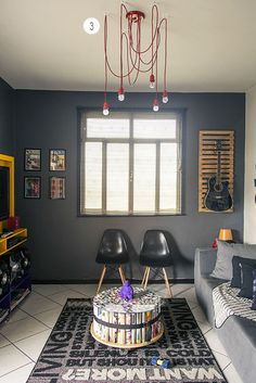 guitar wall and drums in corner and overall rawness of this room