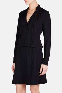 The Proenza Schouler pre-spring 2016 collection is all about the label's signature ability to push clothesmaking to new heights: lightweight tweeds resemble raffia, slinky knits are actually rendered in silk. The innovative approach carries over into fresh silhouettes. This long-sleeved black dress has a plunging, surplice-style neckline and a waist-nipping peplum tempered by subtle bishop sleeves. Satin backing and a hidden side zipper make for a smooth, swingy fit.