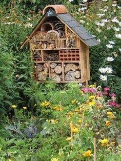 A cute insect house, for native bees and other beneficials.  insect hotels should be close enough to shrubs, trees, garden to provide food for them.