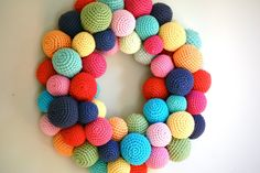 Katie from the AMAZINGLY creative blog Greedy For Colour shares her process in making this crocheted ball wreath. I REALLY love this! You can find the pattern for the balls here. http://greedyforcolour.blogspot.co.nz/2009/09/crochet-l.html