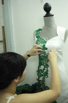 Much time and thought is spent adjusting the lace portions to create the most visually stunning effect. And it has to be done on the mannequin (raising your hands constantly till they ache!)