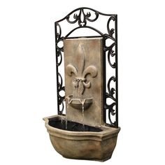"""Old world elegance defines the Bordeaux Outdoor Wall Fountain. It features a classic French lily """"Fleur de Lis"""", a symbol with rich history and bold flair. Combine that with the decorative metal frame"""