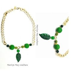 Gold Link chain necklace with green jade leaf.