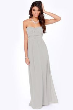 Dressy beach weddings can be tricky because you want something with no-fuss that's still fancy enough. After all, there's the sand and sea breeze to consider. This simple maxi strikes the perfect balance. To dress it up, carry a festive clutch and play around with jewelry.Lulus Exclusive Slow Dance