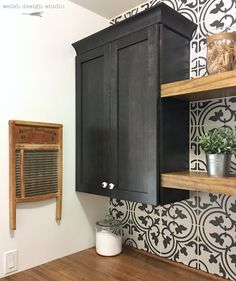 Our laundry room makeover featuring beautiful patterned black and white tile, and vintage decor.
