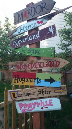 My own version of a decorative direction post. Very low cost project: I used a slightly crooked clearance 4x4 for $2 and repurposed pallets for the signs.
