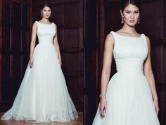 Simple, elegant and chic gown from Augusta Jones Fall 2014.  Augusta Jones available at Cocoa Couture Pinned from www.dreamweddingspa.com