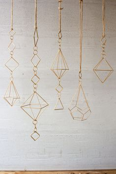 Who says ornaments are for the holidays? Touches of Gold. Set of 5 Gold Wire Geometric Wire Hanging Ornaments Sold in Boxes of: 1 Each Product Dimensions: longest Wire Crafts, Diy And Crafts, Arts And Crafts, Christmas Holidays, Christmas Crafts, Christmas Decorations, Painted Fox Home, Wire Ornaments, Hanging Ornaments