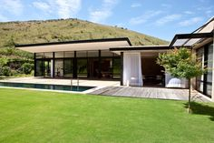 """Swellendam House by GASS. This new residential dwelling is situated in Swellendam at the door-step of the breathtaking mountains and valleys of Langeberg Mountains – a view so magnificent that the locals have named it """"God's Window. Architecture Durable, Contemporary Architecture, Interior Architecture, Glass Building, Building A House, Design Exterior, Casas Containers, Boutique Homes, Facade House"""