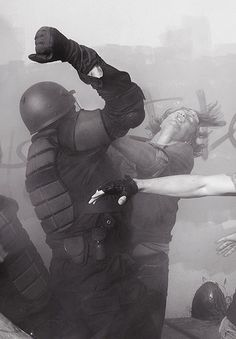"""""""Elbow to the face!"""" Shouts policeman. """"Ooof"""" says the citizen's face!"""