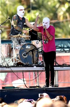 Twenty One Pilots perform onstage during the 2013 iHeart Radio Music Festival