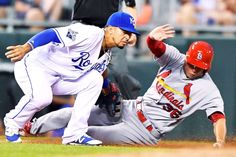 Tagged out:   Kansas City Royals third baseman Cheslor Cuthbert tags out St. Louis Cardinals' Aledmys Diaz trying to steel third during the sixth inning on Monday, June 27, at Kauffman Stadium in Kansas City, Mo.
