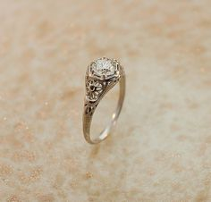 Hey, I found this really awesome Etsy listing at http://www.etsy.com/listing/94420169/1920s-diamond-ring-exquisite-very-high