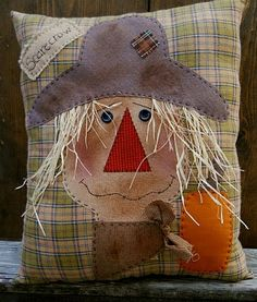 cute scarecrow pillow.  Need this on my porch chair NOW!
