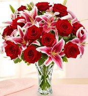Roses symbolize love and when gifted to someone special, roses help to rightly convey the feelings of heart. It contains 10 Red Roses and 5 Lilies with Vase. http://www.onlinedelivery.in/flowers-delivery-in-ahmednagar.aspx