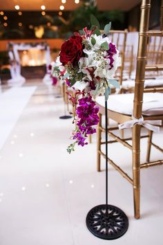 Gorgeous aisle markers and gold chiavari chairs for an elegant boho wedding (Limelight Photography)