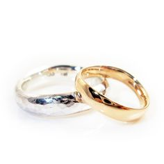 Her ring was to be created of rose gold, while his should be silver. Hers was polished absolutely shiny, while his was hammered. Next to each other, they were absolute contrasts, but they shared one feature: the softly curved shape.