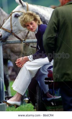 Princess Diana sitting on boot of Prince Charles Aston Martin at Guards Polo Club Windsor