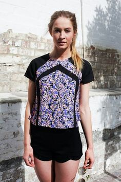 BORDERLINE TOP - Strong graphic top with great structure. Awesome print. edgy cut.Perfect back with tight black licks and killer kicks!