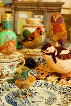 embroidered birds on teacups...that just happened.