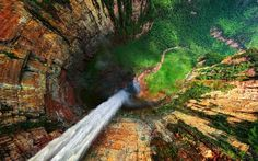 In this incredible capture by Dmitry Moiseenko, we look down the jaw-dropping Dragon Falls in Venezuela. Known locally as Churun Meru, it's apparently about 10 km south of Angel Falls in the same valley. Angel Falls Venezuela, Places To Travel, Places To See, Places Around The World, Around The Worlds, Beautiful World, Beautiful Places, Amazing Places, Beautiful Pictures