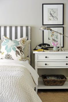 love the striped headboard, bedside table, art and the lamp. soft grey wall colour and sisal rug make this a cozy, clean and vibrant bedroom, excellent feng shui! more bedroom tips here http://fengshui.about.com/od/love/qt/perfectbedroom.htm