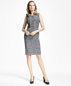 """Crafted from Italian black-and-white tweed, this sleeveless sheath dress offers a sexy yet modest look for the office with flattering fringe detail to define the bust and accentuate the waist. The interior is fully lined with a center back zipper and back vent for ease of movement.<br><br>39"""" center back length; dry-clean only; woven in France; imported."""