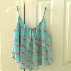 Flamingo Crop Top Got from a friend but unfortunately it's too big for me. Used but in good condition! Blue slip underneath and adjustable straps. Perfect for summer!  NO TRADES. NO HOLDS. NO MERC@RI  Please make any offers through the offer button   Questions? Just ask! EVERYTHING MUST GO! Ask me about my bundle discounts!  Rue 21 Tops Crop Tops