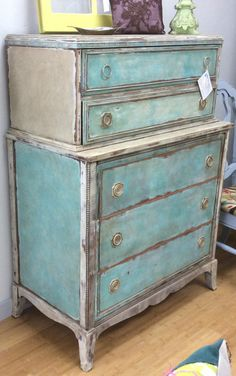 Delightful vintage chest on chest was created with Farmhouse Paints - Creamy Linen, Turquoise Toulouse, Aqua Provence, White Ash, and aged with Farmhouse Tea Stain Antiquing Gel #farmhousepaint #singlestep #noprep #nowax