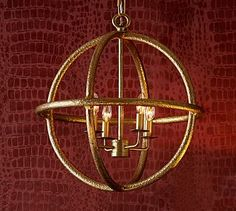 Gold Sphere Pendant. Would love something like this over dinner table