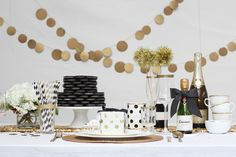 #gold, #bunting, #garland, #glitter, #banner, #dessert-table, #birthday-party, #buffet, #sparkle, #black-and-white  Photography: Laura Clarke Photography - lauraclarkephotos.com/lauraclarkephotos.com/  Read More: http://www.stylemepretty.com/living/2014/02/07/black-white-birthday-party/